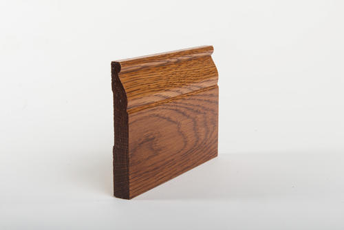 1760 Millwork 5/8 x 5 1/4 x 7' 6 Red Oak Base Moulding Prefinished Cherry Kiss