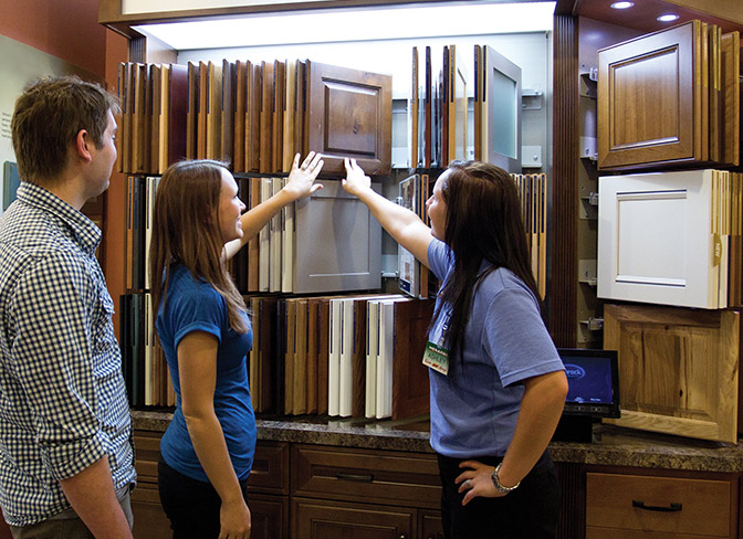 A couple looking at cabinet samples.